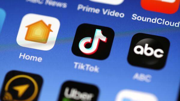 In this photo illustration, the Tik Tok app is displayed on an Apple iPhone on November 01, 2019 in San Anselmo, California - Sputnik International