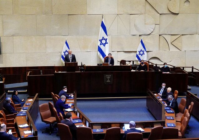 Benny Gantz, centrist Blue and White leader, and Israeli Prime Minister Benjamin Netanyahu's partner in his new unity government, speaks during a swearing in ceremony of the new government, at the Knesset, Israel's parliament, in Jerusalem May 17, 2020.
