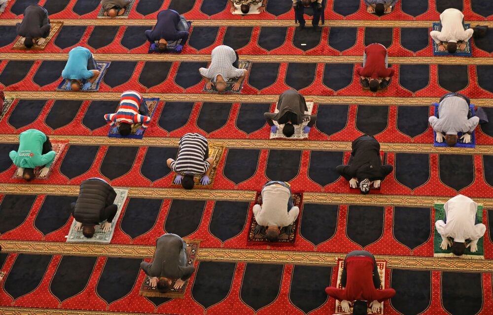 Worshippers perform Friday prayers during the Muslim holy month of Ramadan, while keeping a safe distance from each other, at the Mohammed Al-Amin Mosque in the Lebanese capital Beirut, after some measures taken by the authorities in a bid to prevent the spread of the novel coronavirus were eased, on 8 May 2020.