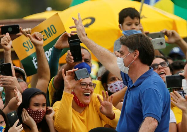 Brazil's President Jair Bolsonaro greets supporters during a protest against the President of the Chamber of Deputies Rodrigo Maia, Brazilian Supreme Court, quarantine and social distancing measures, amid the coronavirus disease (COVID-19) outbreak, in Brasilia, Brazil May 17, 2020