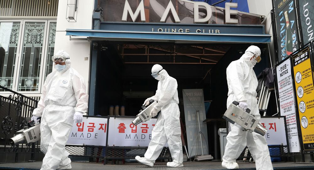 Quarantine worker sprays disinfectants in front of a night club on the nightspots in the Itaewon neighborhood, following the coronavirus disease (COVID-19) outbreak, in Seoul, South Korea, 12 May 2020.