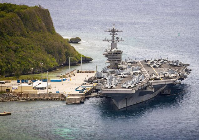 The aircraft carrier USS Theodore Roosevelt (CVN 71) is moored pier side at Naval Base Guam May 15, 2020. Theodore Roosevelt's COVID-negative crew returned from quarantine beginning on April 29 and is making preparations to return to sea to continue their scheduled deployment to the Indo-Pacific.