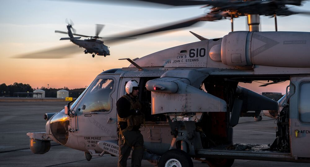 A U.S. Navy MH-60S Seahawk aircrew member, assigned to the Helicopter Sea Combat Squadron 14, prepares for a close air support training scenario during Southern Strike 2020 at the Gulfport Combat Readiness Training Center, Miss., Feb. 2, 2020