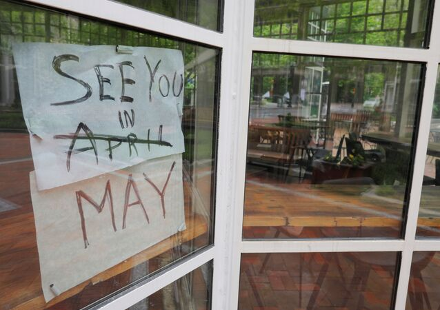 The sign on Sip Cafe reads See you in May, with April crossed out, amid the coronavirus disease (COVID-19) outbreak in Boston, Massachusetts, U.S., May 18, 2020.
