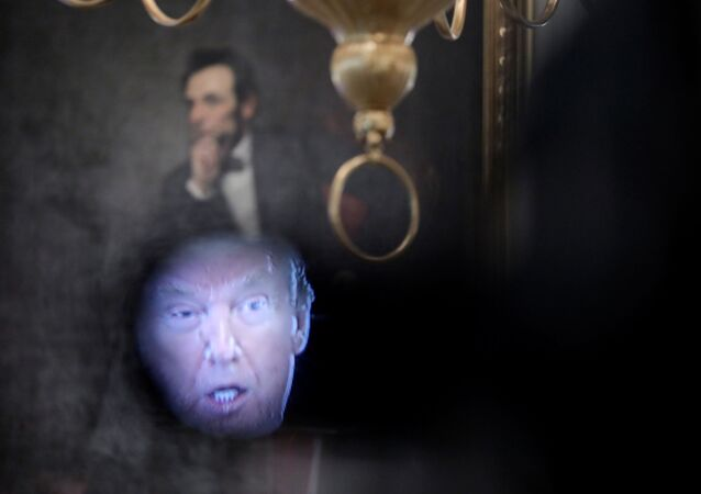 U.S. President Donald Trump is seen in the viewfinder of a television camera positioned in front of a portrait of former President Abraham Lincoln during a roundtable discussion with industry executives on the administration's plan for Opening Up America Again? amid the coronavirus disease (COVID-19) pandemic at the White House in Washington, U.S., April 29, 2020
