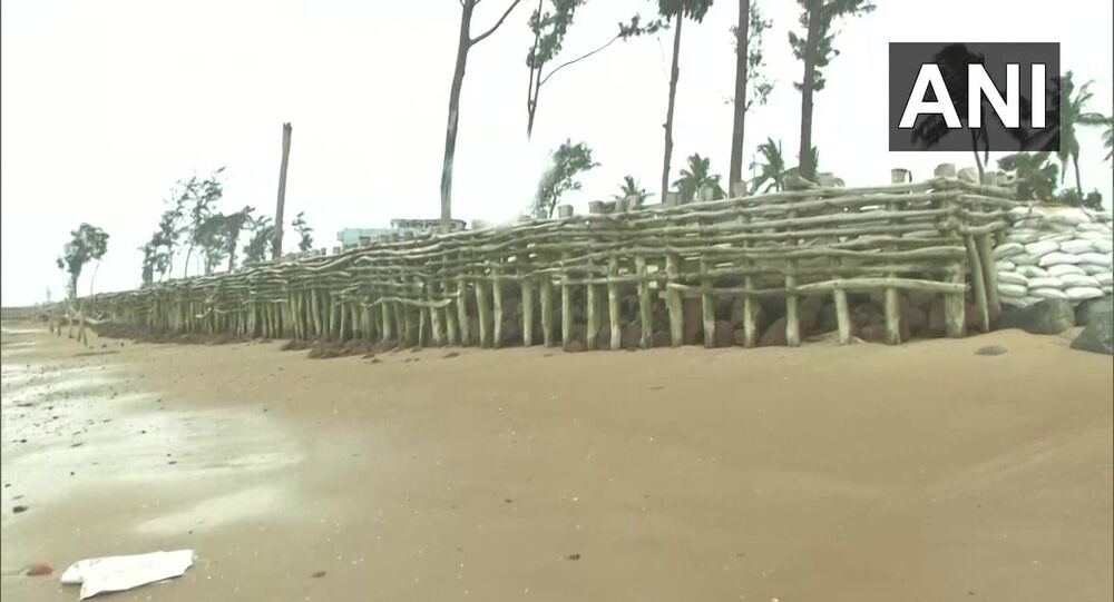 West Bengal: Residents of Tajpur, East Medinipur create a temporary fence along the coast, in the wake of  Amphan Cyclone