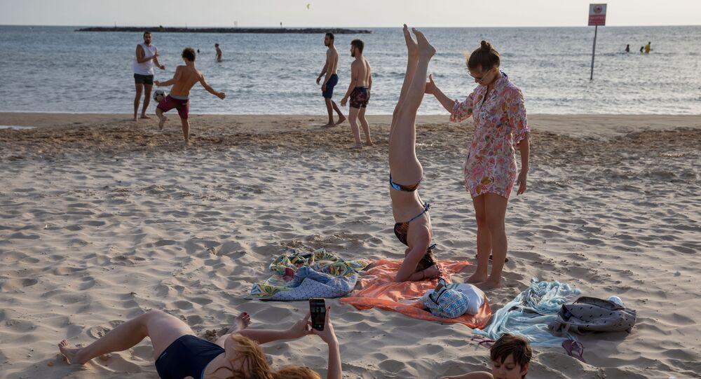 People enjoy the beach front in Tel Aviv, Israel, Saturday, May 16, 2020