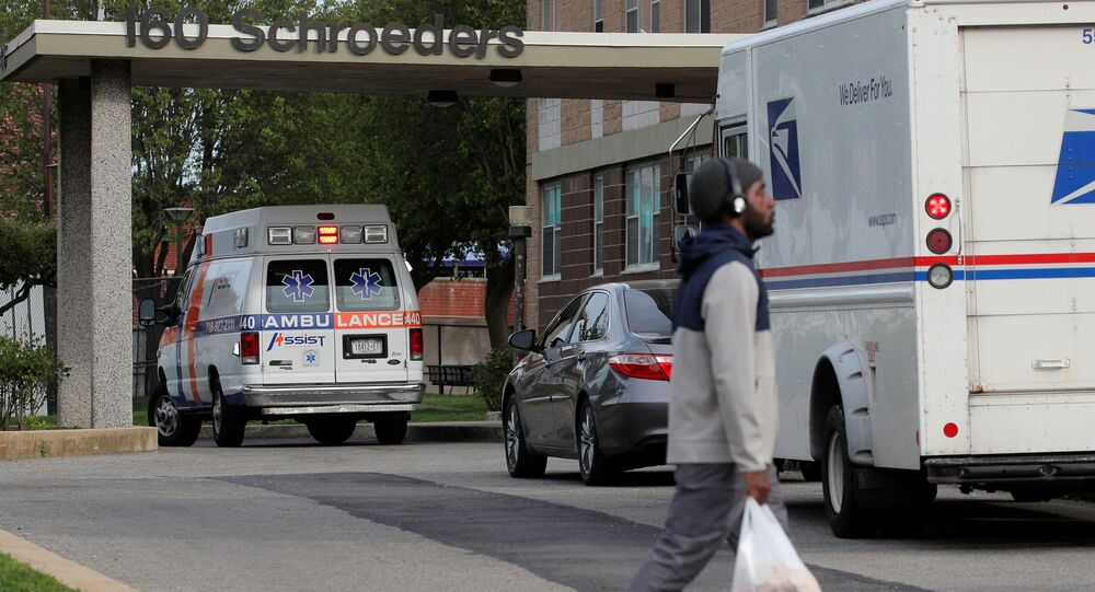 An ambulance is parked outside a building, during the outbreak of the coronavirus disease (COVID-19), in the Starrett City neighborhood in the Brooklyn borough of New York, City, New York U.S., May 18, 2020.