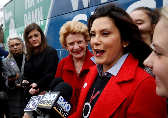 Michigan Democratic gubernatorial candidate Gretchen Whitmer and US Sen. Debbie Stabenow talk to reporters at her polling station at the St. Paul Lutheran Church in East Lansing, Michigan, 6 November 2018.