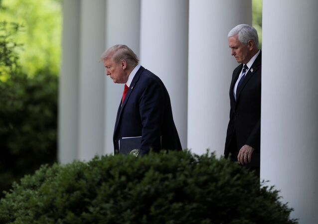 U.S. President Donald Trump is followed by Vice President Mike Pence as he arrives to discuss the administration's coronavirus response at a news conference in the Rose Garden at the White House in Washington, U.S., April 27, 2020.