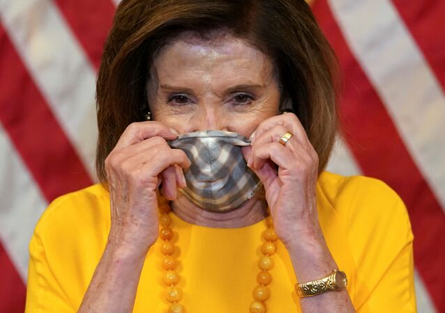 Speaker of the House Nancy Pelosi puts on her face mask to protect from the coronavirus disease (COVID-19) after taking part in a ceremonial swearing-in for Rep. Mike Garcia (R-CA) in Washington, U.S., May 19, 2020