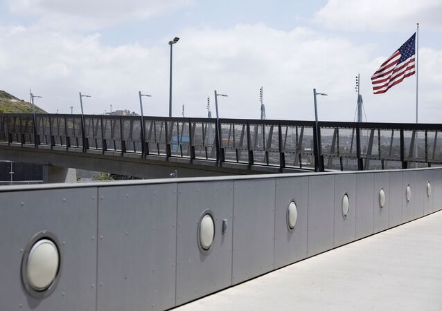 An empty walkway at the U.S.-Mexico border is shown after U.S. President Donald Trump tweeted that he will be signing an Executive Order to temporarily suspend immigration into the United States during the outbreak of the coronavirus disease (COVID-19) in San Diego, California, U.S., April 21, 2020.