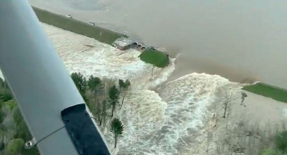 Aerial view of water from a broken Edenville Dam seen flooding the area as it flows towards Wixom Lake in Michigan, U.S. in this still frame obtained from social media video dated May 19, 2020