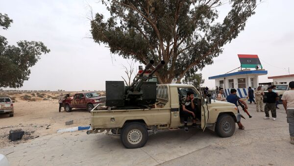 Fighters loyal to Libya's internationally recognised government are seen after taking control of Watiya airbase, southwest of Tripoli, Libya, 18 May 2020.  - Sputnik International