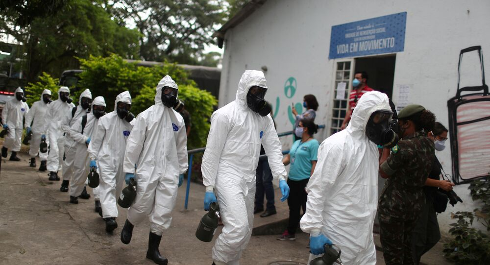 Brazilian army officers wearing protective gears arrive to disinfect the shelter Stella Maris Complex for elderly people, homeless and patients with mental disorders managed by the Rio de Janeiro City Hall amid concerns of the spread of the coronavirus disease (COVID-19), in Rio de Janeiro, Brazil May 14, 2020