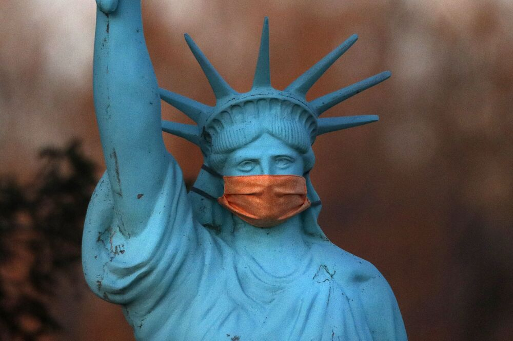 A replica of the Statue of Liberty wears a coronavirus mask outside a home on Deer Isle, Maine, 6 May 2020.