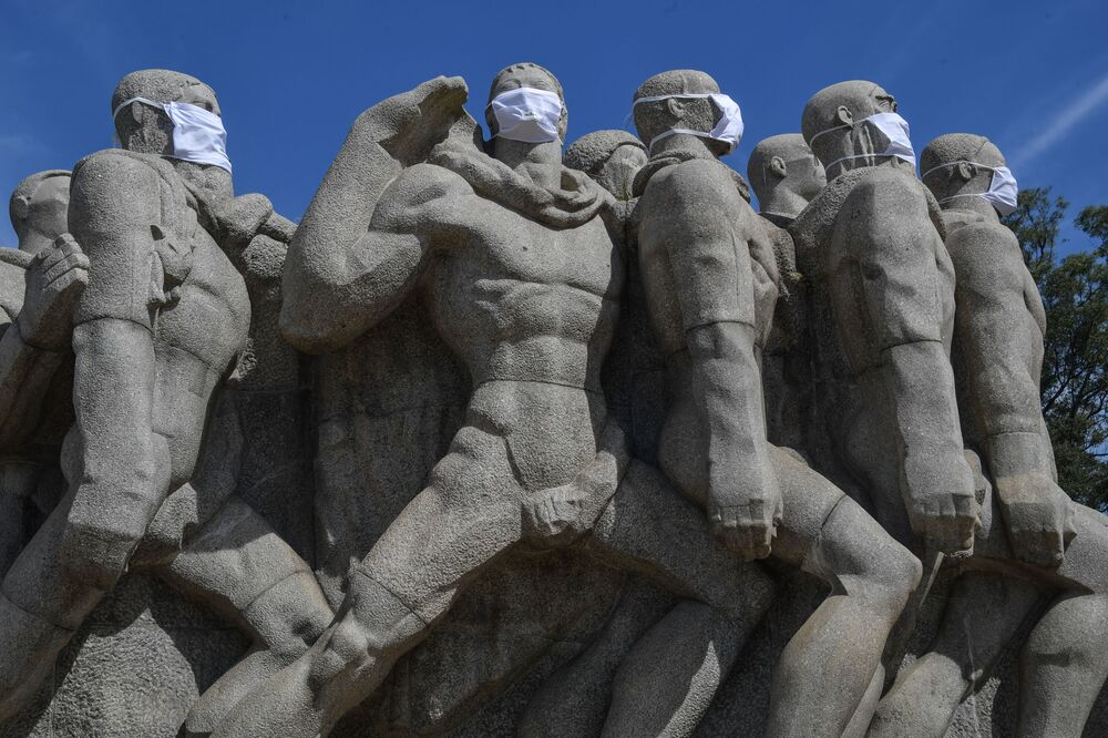 Statues of the Monumento das Bandeiras wear face masks in Sao Paulo, Brazil, on 12 May 2020, during the COVID-19 pandemic.