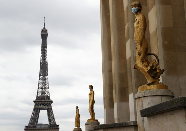 Statues wear masks along Trocadero square close to the Eiffel Tower in Paris, Monday, May 4, 2020.