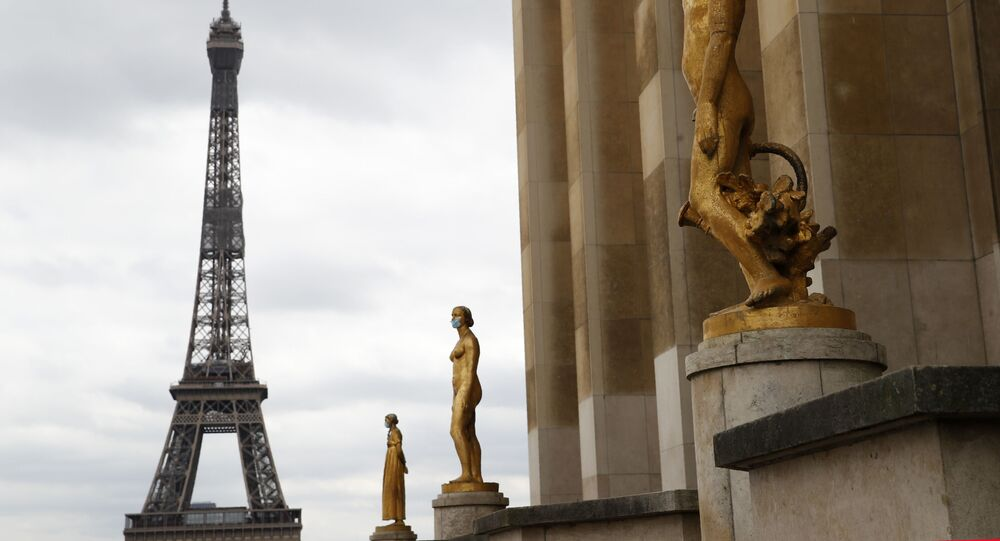 Statues wear masks along Trocadero square close to the Eiffel Tower in Paris, Monday, 4 May 2020.