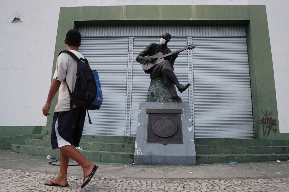 The statue of the Brazilian musician and poet Cartola  is pictured wears a protective mask in front of the Mangueira samba school on the first day of the mandatory use of masks in the city of Rio de Janeiro, amid the coronavirus disease (COVID-19) outbreak, April 23 2020.