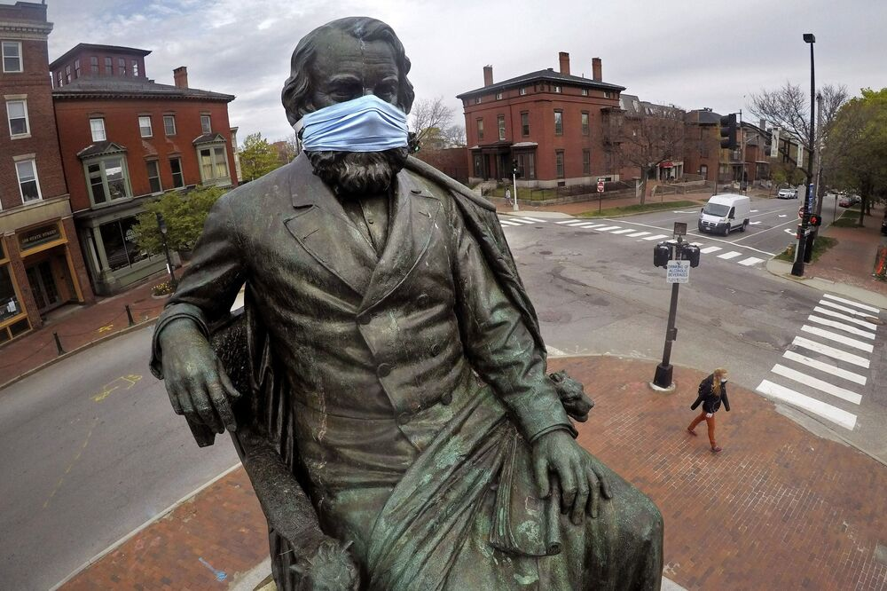 A statue of literary great Henry Wadsworth Longfellow wears a mask in Portland, Maine, 18 May 2020.