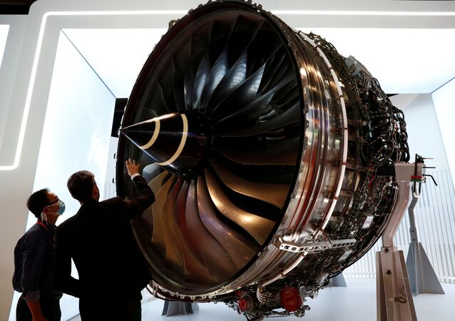 A man looks at Rolls Royce's Trent Engine displayed at the Singapore Airshow in Singapore February 11, 2020