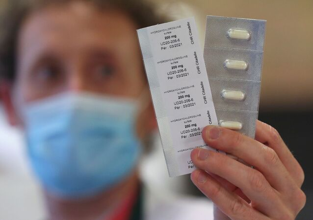 A pharmacy worker shows pills of hydroxychloroquine used to treat the coronavirus disease (COVID-19) at the CHR Centre Hospitalier Regional de la Citadelle Hospital in Liege, Belgium, April 22, 2020