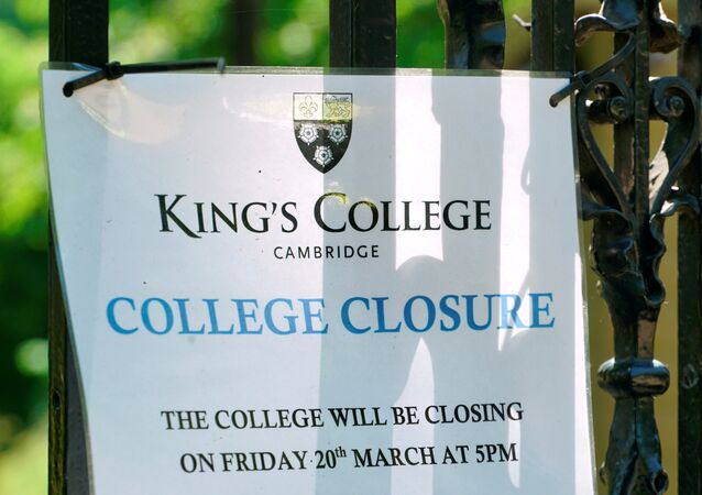 A sign at Kings College Cambridge, announcing its March closure, is displayed on the university's gates amid the novel coronavirus outbreak, in Cambridge, Britain May 20, 2020