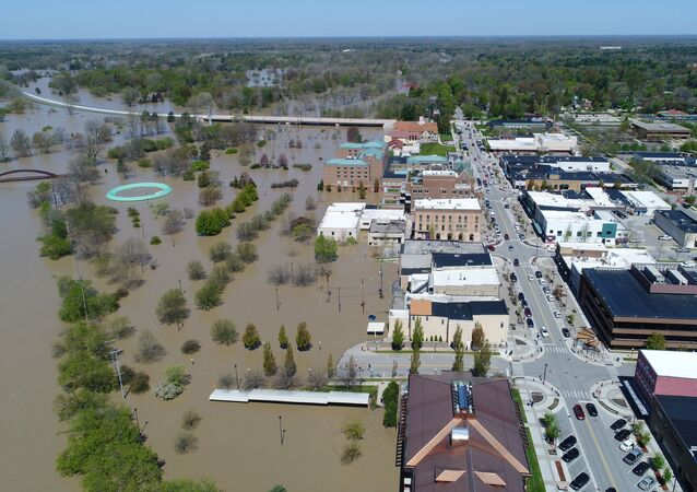 Rising flood waters of the Tittabawassee River advance upon the city after the breach of two dams, Edenville and Sanford, in Midland, Michigan, U.S. May 20, 2020.