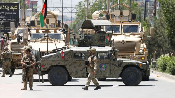 Afghan security forces stand guard outside a hospital which came under attack in Kabul - Sputnik International