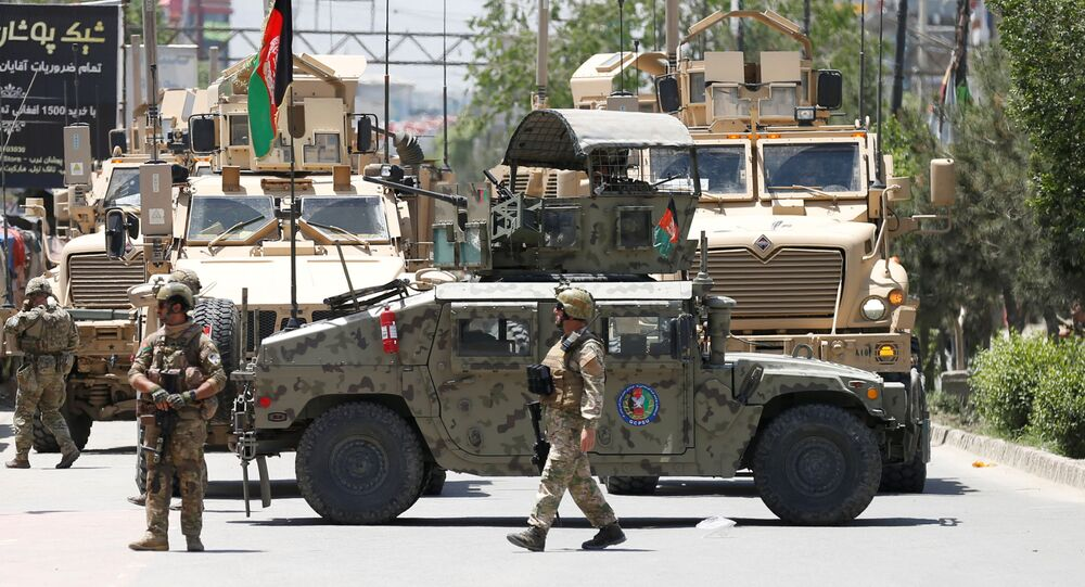 Afghan security forces stand guard outside a hospital which came under attack in Kabul