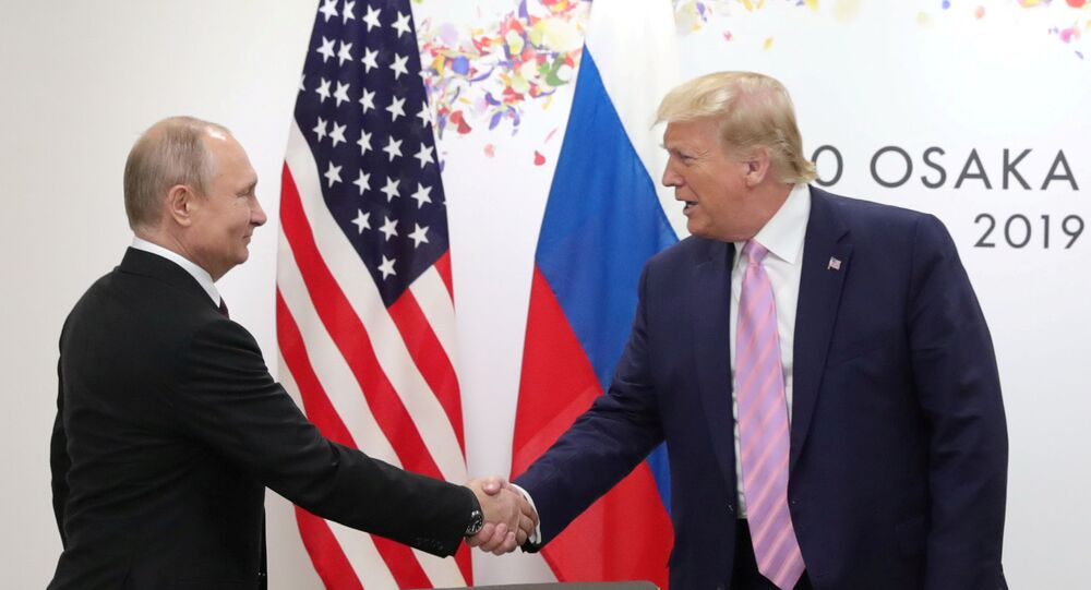 Russia's President Vladimir Putin shakes hands with U.S. President Donald Trump during a meeting on the sidelines of the G20 summit in Osaka, Japan June 28, 2019.