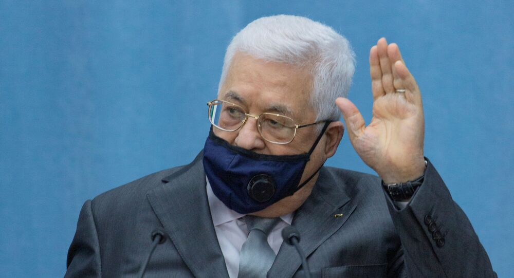 Palestinian President Mahmoud Abbas wears a mask as he heads the Palestinian leadership meeting at his headquarters, in Ramallah in the Israeli-occupied West Bank May 7, 2020