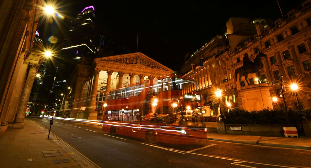 An empty bus is driven through the quiet streets outside the Bank of England in the early hours, as the city is deserted at night like never before, while the coronavirus disease (COVID-19) lockdown continues, in London, Britain April 22, 2020