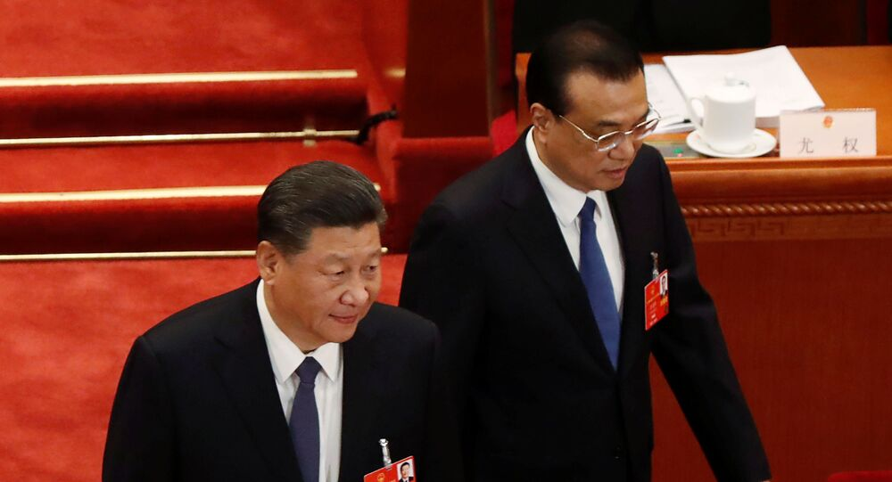 Chinese President Xi Jinping and Premier Li Keqiang arrive at the opening session of the National People's Congress (NPC) at the Great Hall of the People in Beijing, China May 22, 2020