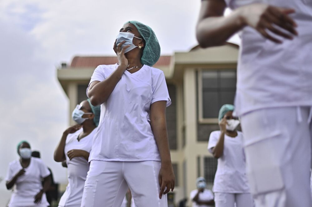 Nurses assigned to the Infectious Diseases Unit (IDU) at the Kenyatta University Hospital dance during a Zumba class held at the hospital compound in Nairobi, on 17 May 2020. Coinciding with the morning shift rotation the class, aimed to offer some respite to nurses charged with the management of patients infected with COVID-19 coronavirus, was organised by the Nursing Council of Kenya (NCK) and the Kenyatta Univesity Teaching, Refferal and Research Hospital in the Kenyan capital.