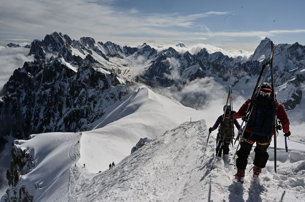 Mountaineers ski to the 'Vallee Blanche' a glacial valley located in the Mont-Blanc massif, from the 'Aiguille du Midi' peak in Chamonix, on 16 May 2020, on the first day of the reopening as France eases lockdown measures taken to curb the spread of the COVID-19 pandemic, caused by the novel coronavirus.