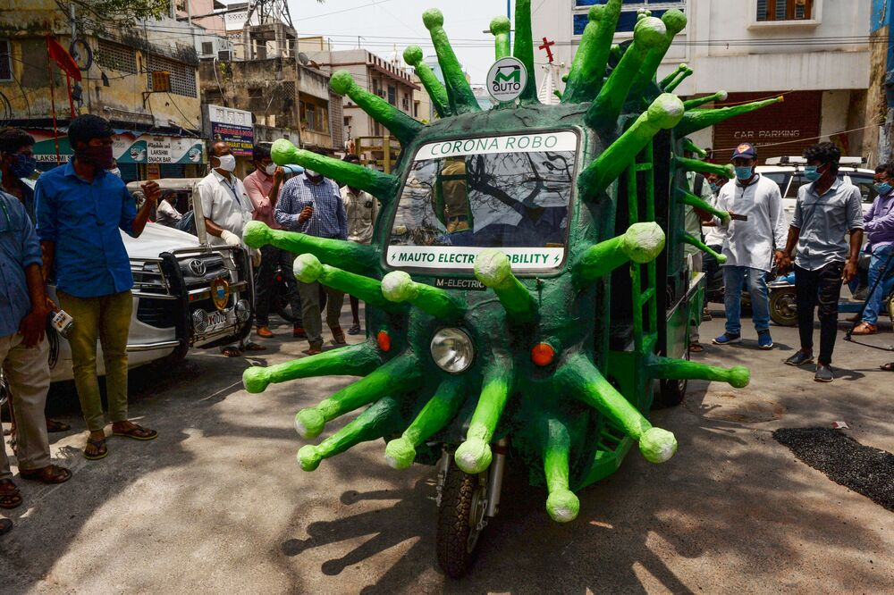 A municipal worker drives a coronavirus-themed auto-rickshaw in a street of a residential area after the government eased a nationwide lockdown in Chennai.