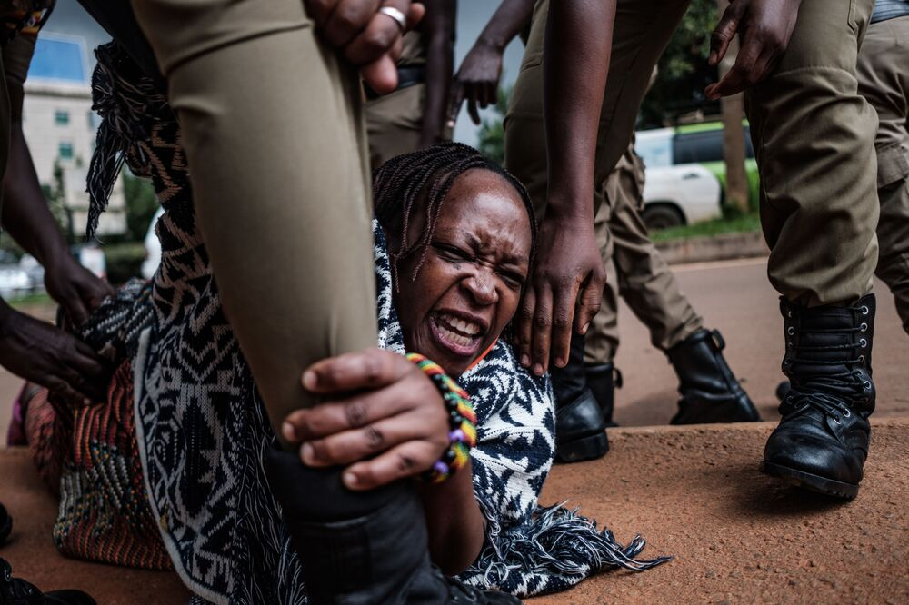 Stella Nyanzi (C), a prominent Ugandan activist and government critic, is arrested by police officers as she organised a protest for more food distribution by the government to people who has been financially struggling by the nationwide lockdown imposed to curb the spread of the COVID-19 coronavirus in Kampala, on 18 May 2020.