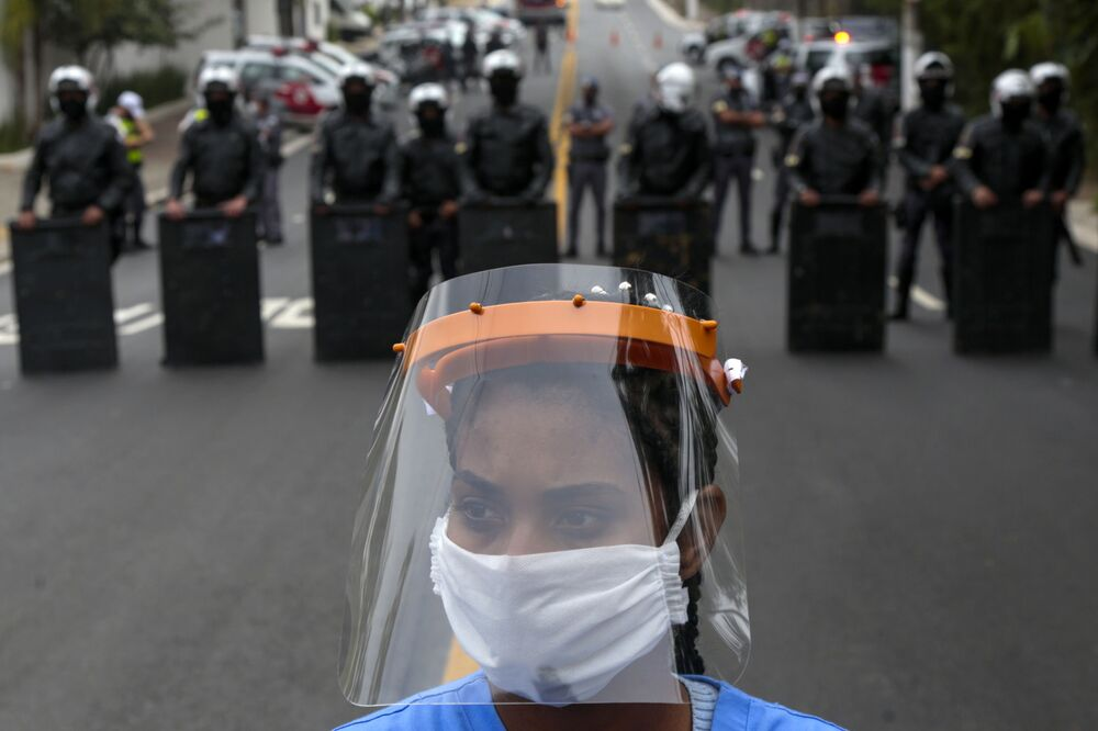 A resident of Paraisopolis, one of the city's largest slums, takes part in a protest in Sao Paulo, Brazil, on 18 May 2020, to demand more aid from Sao Paulo's state government during the COVID-19 coronavirus pandemic.