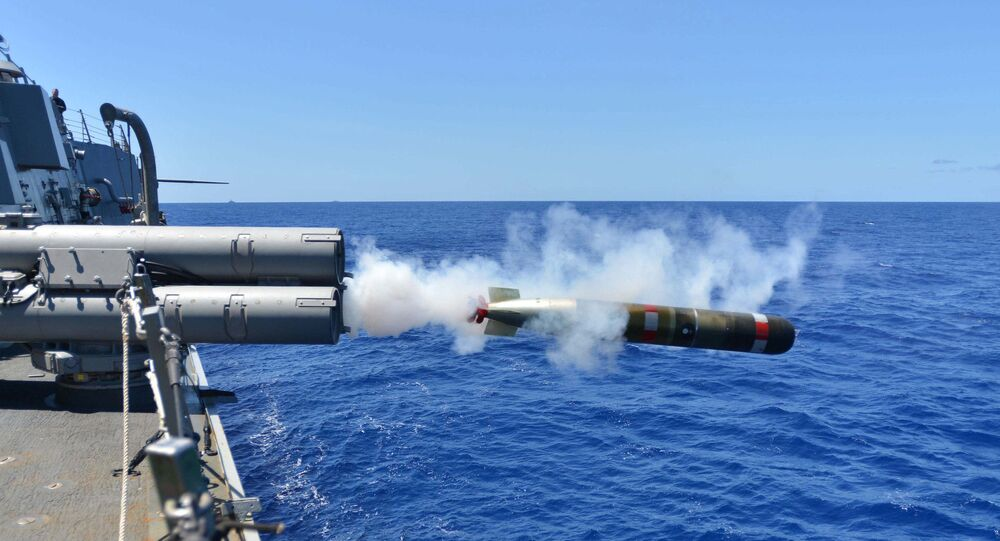 A MK 54 exercise torpedo launches from the Arleigh Burke-class guided-missile destroyer USS Lassen (DDG 82)