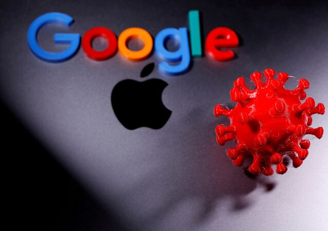 3D printed coronavirus model and Google logo are placed near an Apple Macbook Pro in this illustration, taken 12 April 2020