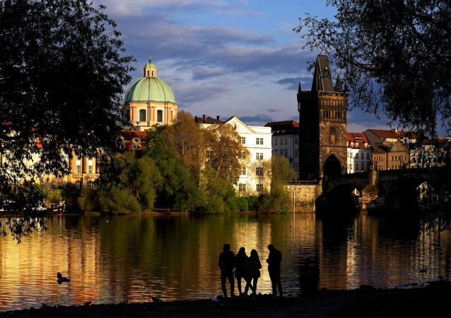 People stand on the Vltava river bank amid an outbreak of the coronavirus disease (COVID-19) in Prague, Czech Republic, April 29, 2020
