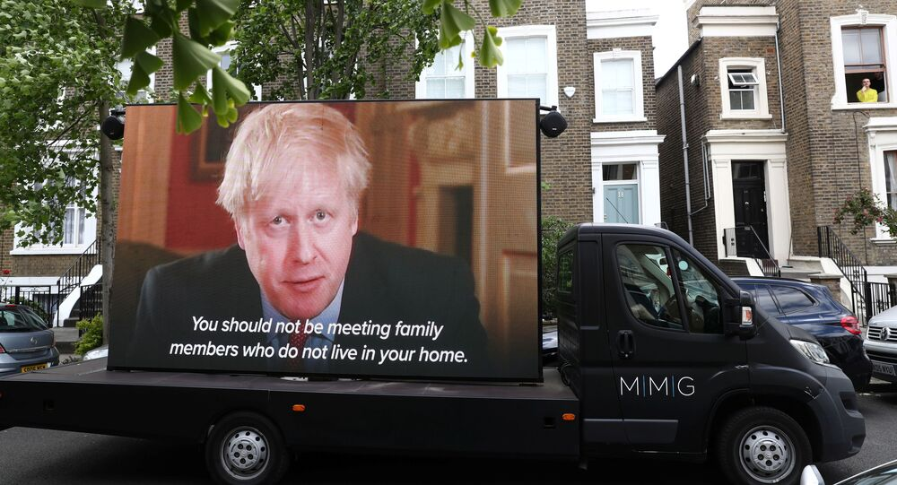 A Led by donkeys truck displaying a video of Britain's Prime Minister Boris Johnson, drives by Dominic Cummings' house in London, following the outbreak of the coronavirus disease (COVID-19), London, Britain, May 24, 2020.