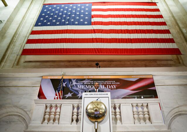 A staff member rings closing bell in honor of Memorial Day and the lives lost in military service to the U.S., as preparations are made for the return to trading, on the floor at the New York Stock Exchange (NYSE) in New York, U.S., May 22, 2020.