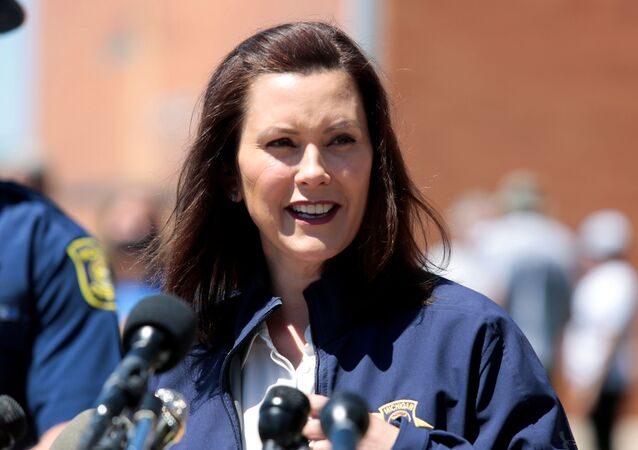Michigan Governor Gretchen Whitmer addresses the media about the flooding along the Tittabawassee River, after several dams breached, in downtown Midland, Michigan, U.S., May 20, 2020.