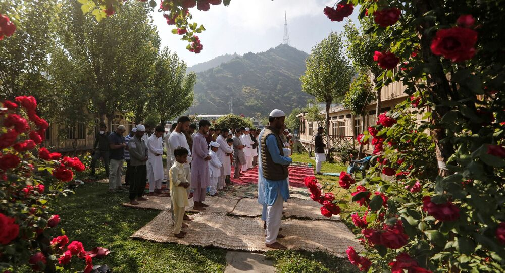 Kashmiri Muslims pray in the garden of a house while celebrating Eid al-Fitr, the Muslim festival marking the end of the holy fasting month of Ramadan, amid the spread of the coronavirus disease (COVID-19) outbreak in Kashmir May 24, 2020