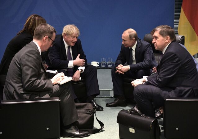 Britain's Prime Minister Boris Johnson and Russian President Vladimir Putin speak during a meeting on the sidelines of an international peace conference on Libya in Berlin, Germany
