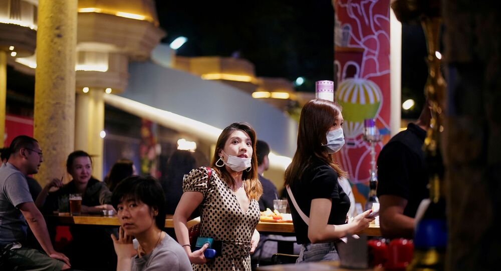 People wear face masks at a bar area after it reopened following a shutdown due to the coronavirus disease (COVID-19) outbreak, in Shanghai, China May 22, 2020.