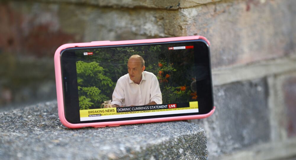 A mobile phone is seen resting on a wall outside the house of Dominic Cummings, special advisor for Britain's Prime Minister Boris Johnson, as it displays a live stream of a statement by Cummings following the outbreak of the coronavirus disease (COVID-19), London, Britain, May 25, 2020.